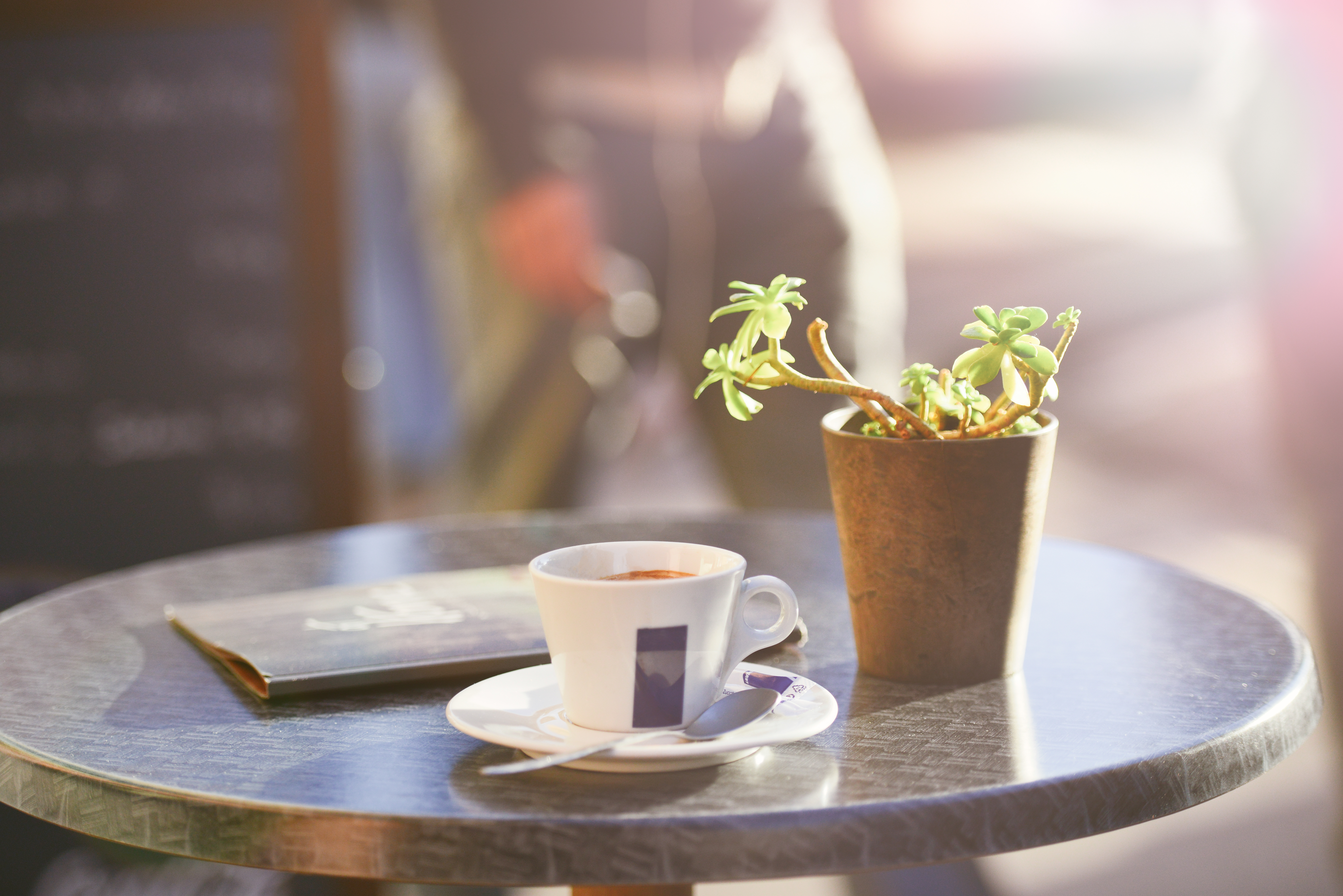 https://gathermoments.files.wordpress.com/2015/01/morning-coffee-on-outside-cafe-table-with-plant-menu.jpg